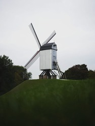 Panoramic view of historic traditional Bonne Chieremolen windmill post mill in Bruges West Flanders Flemish Belgium