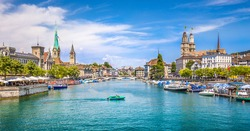 Panoramic view of historic Zurich city center with famous Fraumunster and Grossmunster Churches and river Limmat at Lake Zurich on a sunny day with clouds in summer, Canton of Zurich, Switzerland