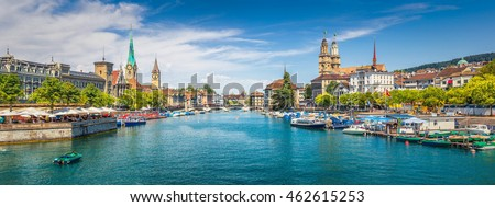 Panoramic view of historic Zurich city center with famous Fraumunster, Grossmunster and St. Peter and river Limmat at Lake Zurich on a sunny day with clouds in summer, Canton of Zurich, Switzerland #462615253