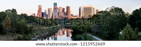 Panoramic view of Houston downtown skyline and reflection in Buffalo Bayou in late afternoon sunlight Stok fotoğraf ©