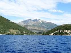 Panoramic view of Ionian island near Nydri village in Lefkada in Greece. Tourists visit Nydri for vacations for its natural mountainous and seascape, also choices of bars and restaurants.