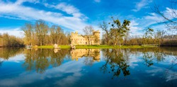 Panoramic view of Janohrad (also known as Januv Hrad) - ancient ruin above river with magic reflection in water. Part of Lednice Valtice UNESCO areal. Czech Republic, Sputh Moravia region.