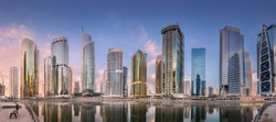 Panoramic view of Jumeirah Lakes Towers in Dubai during sunny morning, United Arab Emirates