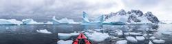 Panoramic view of kayaking in the Iceberg Graveyard in Antarctica, incredible POV panorama with sea and ice, Antarctic Peninsula