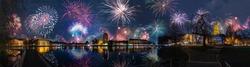 Panoramic view of Kiel skyline, Kiel Opera House, the town Hall by Kleiner Kiel by night with firework.  Fireworks over Kiel, Schleswig-Holstein, Germany