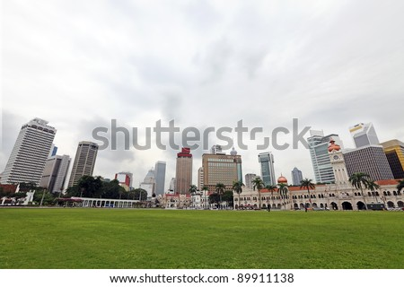 Panoramic view of Kuala Lumpur city skyline from the historic Merdeka Square against a sky with the cloud in motion.