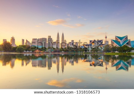 Panoramic view of Kuala Lumpur city waterfront skyline with reflections and beautiful morning sky, Titiwangsa Park, Malaysia. Big size