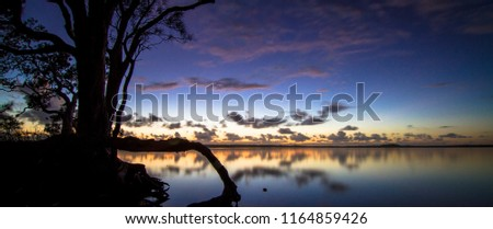 panoramic view of lake at dawn before sunrise with clouds in background