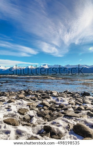 Shutterstock Panoramic view of Lake Fagnano in Argentinean Patagonia, Ushuaia, Tierra Del Fuego. Tranquil scene and amazing background. Long exposure picture of Lake Fagnano in Tierra Del Fuego, Argentina