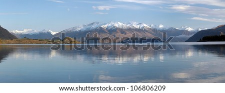 Panoramic view of Lake Wanaka and the Southern Alps of New Zealand. Plenty of copy space available. The Hobbit and Middle-earth filming location. - stock photo