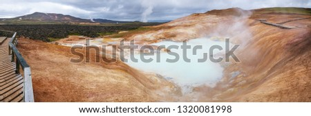Panoramic view of Leirhnjukur (Clay Hill) rhyolite formation with hot sulfuric springs at Krafla volcanic area in Mývatn region, Northeastern Iceland, Scandinavia