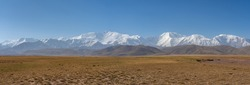 Panoramic view of Lenin Peak nowadays Ibn Sina peak and the snow-capped Trans-Alai mountain range in southern Kyrgyzstan
