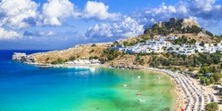 panoramic view of  Lindos bay, village and Acropolis, Rhodes, Greece