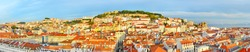 Panoramic view of Lisbon with Lisbon Castle on top of a hill at sunset. Portugal