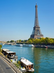 Panoramic view of living barge on the Seine in Paris with Eiffel tower backround. France