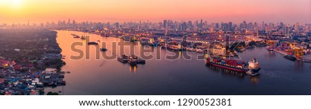 panoramic view of Logistics and transportation of Container Cargo ship and Cargo plane with working crane bridge in shipyard at sunrise, logistic import export and transport industry background