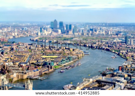 Panoramic View of London, UK, over the river Thames towards Canary Wharf and Eastern London. Tilt-shift effect applied - stock photo