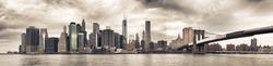 Panoramic view of Manhattan Bridge and skyline in New York City.