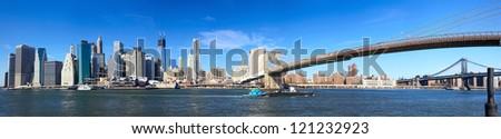 Panoramic view of Manhattan skyline and Brooklyn Bridge in New York City