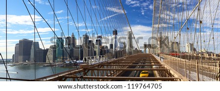 Panoramic view of Manhattan skyline from Brooklyn Bridge, New York City - stock photo