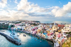 Panoramic view of Marina Corricella, a seaside fishing village in Procida island, with colorful buildings, harbor and boats, in Procida Island, province of Naples, Italy