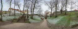 Panoramic view of medieval stone castle ruins with old stone stairs in the park