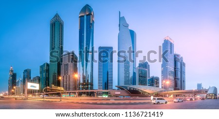 Panoramic view of metro station and road in Financial district during overcast day, Dubai, UAE.