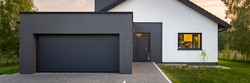 Panoramic view of modern house with garage and green lawn