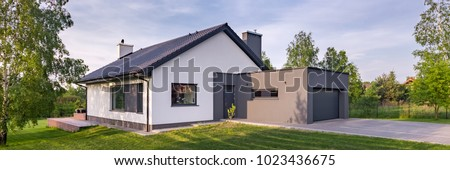 Panoramic view of modern one-story house with garage and sliding roof #1023436675