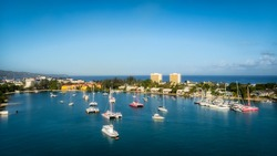 Panoramic view of Montego Bay, Jamaica on a stunning spring day featuring boats floating in the emerald waters of the bay