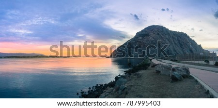 Panoramic view of Morro Rock at sunset, Morro bay, California
