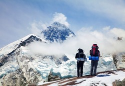 Panoramic view of Mount Everest from Kala Patthar with two tourists on the way to Everest base camp, Sagarmatha national park, Khumbu valley - Nepal