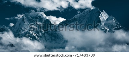 "Panoramic view of mountain peaks Kangtega, also known as ""The Snow Saddle"" (6,782 m.) and Thamserku (6,608 m.). Himalayas, Khumbu, Eastern Nepal #717483739"