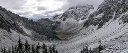 Panoramic view of mountain valley in winter on Cascade Pass trail, North Cascades National Park, WA, USA.