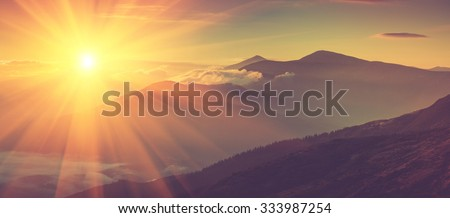 Panoramic view of mountains, autumn landscape with foggy hills at sunrise. Filtered image:cross processed vintage effect.