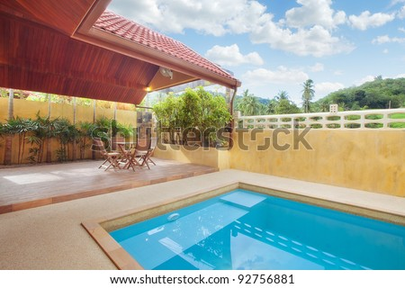 panoramic view of nice summer house patio with swimming pool