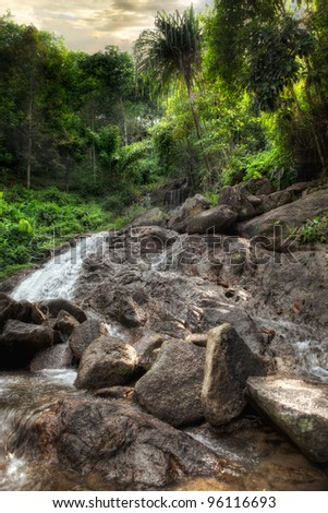 panoramic view of nice tropic jungle and huge boulders