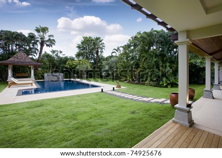 Panoramic view of nice tropic luxury garden with swimming pool