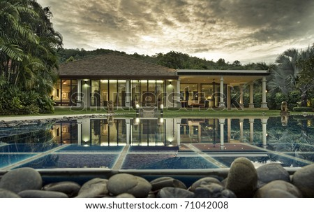 Panoramic view of nice tropic villa during sunset