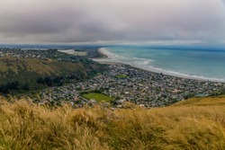 Panoramic view of ocean bay and Sumner Town in stormy day, Christchurch suburbs, New Zealand