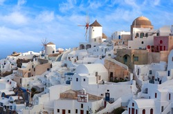 Panoramic view of Oia town at sunset, Santorini island, Cyclades, Greece. Traditional famous white houses, mills and churches over the Caldera in Aegean sea