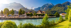 Panoramic view of Old City with thrain station and Aare river. Interlaken, important tourist center in the Bernese Highlands, Switzerland. The Jungfrau is visible in the background