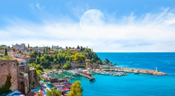 Panoramic view of Old Town port with full moon on the background Mediterrranean Sea  - Antalya, Turkey