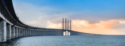Panoramic view of Oresund bridge during sunset over the Baltic sea