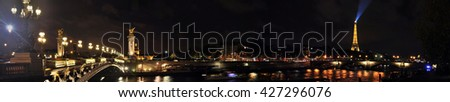 Stock Photo Panoramic View of Paris at night, with streetlights and Eiffel Tower