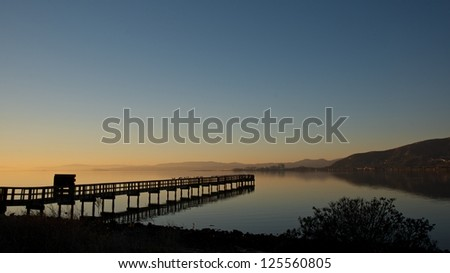 Panoramic view of pier in San Francisco bay at dawn.