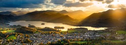 Panoramic view of popular tourist destination; Derwentwater in the Lake District, UK. Rays of light can be seen breaking through the dramatic clouds, illuminating the fells!