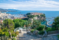Panoramic view of Port and Prince's palace in Monte Carlo and Oceanographic Museum in a summer day, Monaco. French riviera. Mediterranean Sea landscape with beautiful blue sky
