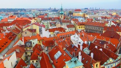 Panoramic view of Prague from the Prague Castle, Czech Republic. Aerial view of Praha city with red roofs.
