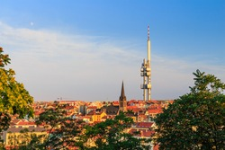 Panoramic view of Prague with red roofs and Zizkov television tower in the background, Prague, Czech republic